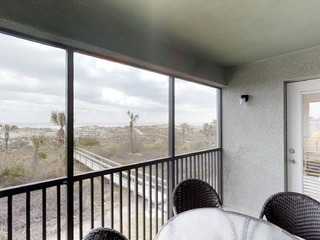 OCEANFRONT 2 bedroom end unit condo. Screened porch and great views!!