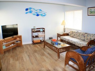 Fall special! Bright and Sunny 3 bedroom top floor condo- Gated, 2 Pools (1 heated) elevator, and beach access