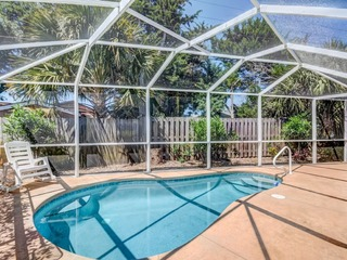 Private 4 bedroom Pool home just steps to beach with screen pool and fenced yard