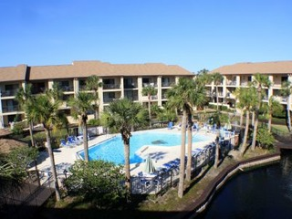 Fall special! Updated 3 bedroom, top floor, elevator, 2 pools (1 heated), beach access and gated.