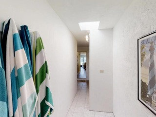 Ponce Landing 53: Cute and Beachy 2 bedroom condo with beach access, heated pool and garage
