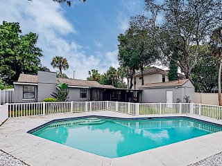 Updated Bungalow w/ Gated Pool & Screened-In Porch
